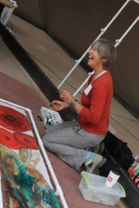 """Mary painting silk at the Dye Day for the Dam in 2013. The scarf was a """"group project"""" in every way. Young and old alike came to paint on the piece"""